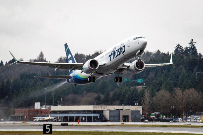 An Alaska 737-9 departs Boeing Field.