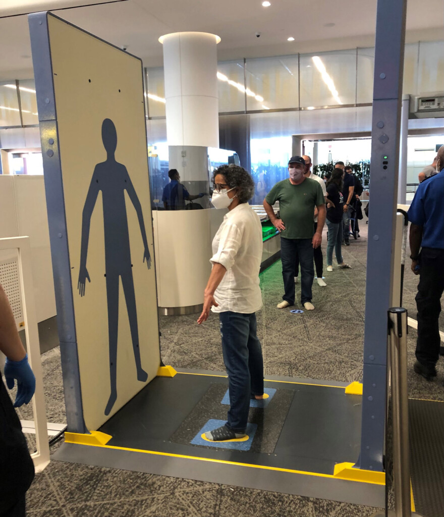 Body scanners with hands down at LGA Airport.