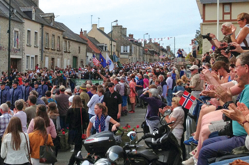 The streets of Ste. Marie Eglise are filled as D-Day Task Force members march into town.