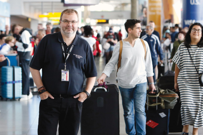 Father Chris Piasta at John F. Kennedy International Airport's Terminal 4.