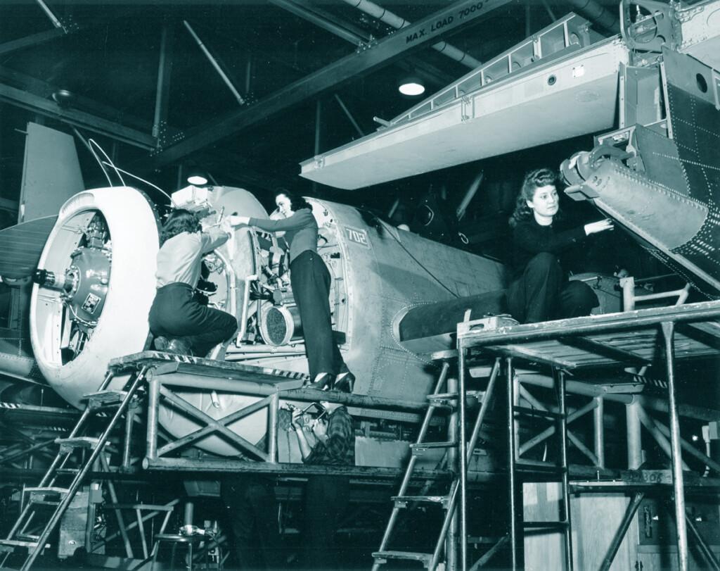 Grumman women workers assembling forward firewall for aircraft 1943.