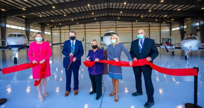 Town of Islip officials join Hawthorne Global Aviation executives to cut the ribbon on the companys new hangar.