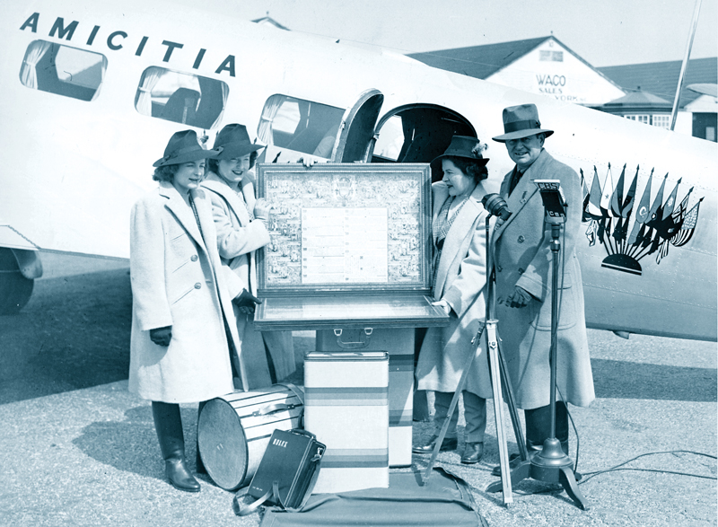 The Hutchinson Family Goodwill Round-the-World Flight with scroll before the Lockheed Electra 'Amicitia' at Roosevelt Field,L.I.