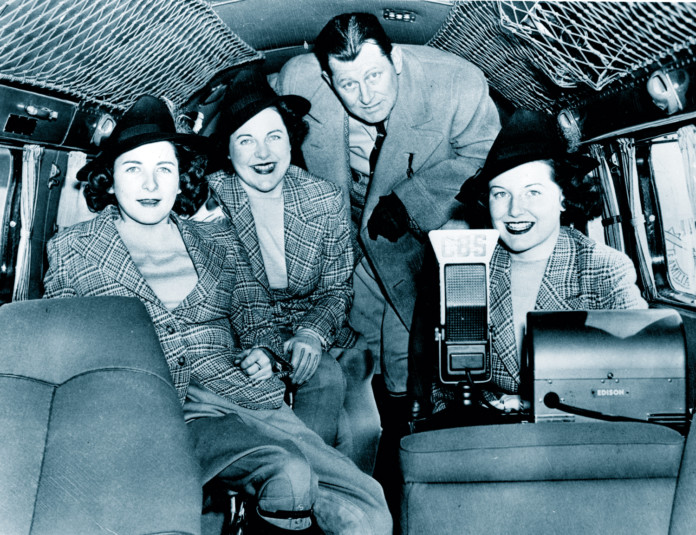 Hutchinson Family,Inside Lockheed Electra 'Amicitia' prior to 49,545 mi. good will flight to 68 nations, Janet (L) Kathryn at radio, Mrs. Blanche Hutchinson & George Hutchinson, Roosevelt Field,L.I.