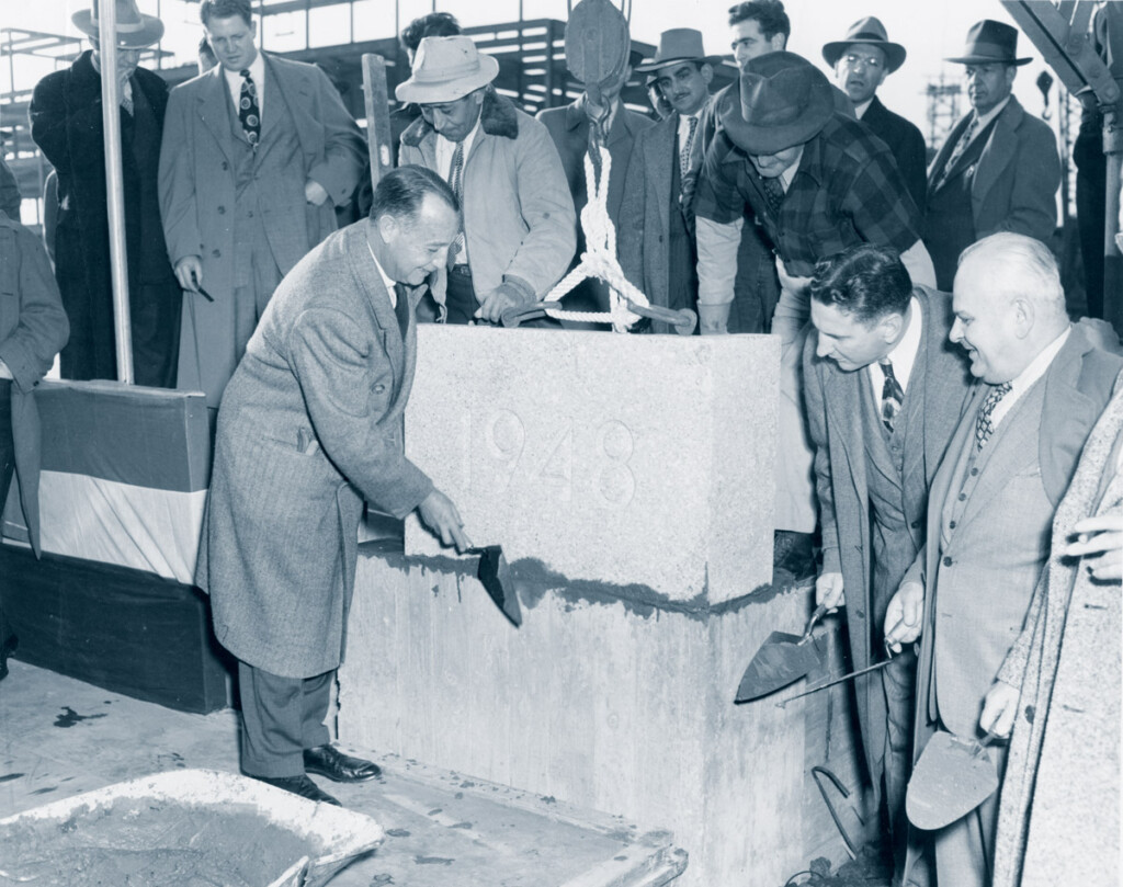 Port Authority Chairman Howard S. Cullman laying cornerstone of Federal Building at Idlewild Airport. D. Rentzel C.A.A. Admin. & Ora Young C.A.A, Regional Admin. looking on. November 8, 1948