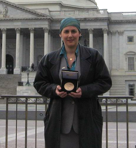 Julia Lauria-Blum, receiving-Marjorie's-Congressional-Gold-Medal-Wash.-DC-March-10,-2010