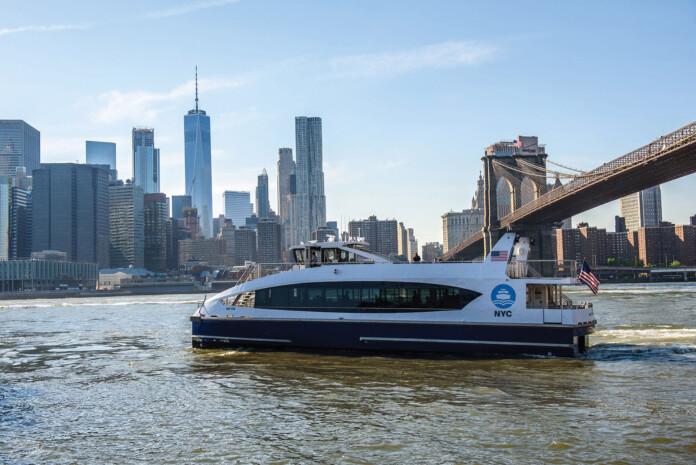 NYC Ferry and Downtown Manhattan Skyline with Brooklyn Bridge