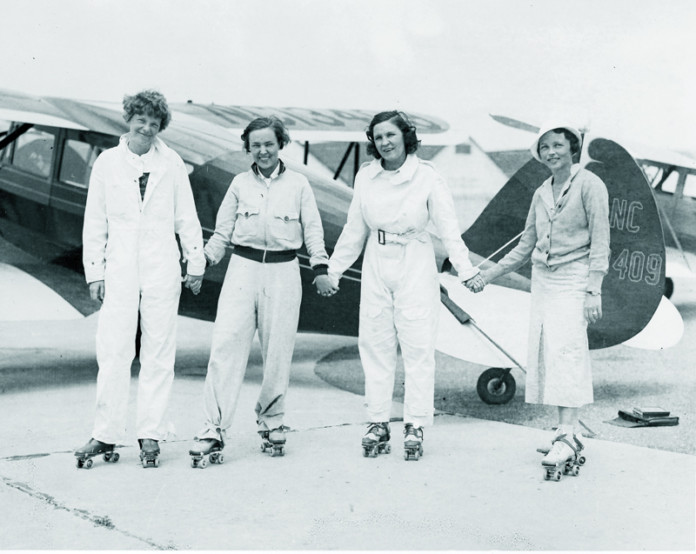 Ninety-Nines roller skating party, 6-16-1933 Roosevelt Field (L-R) Amelia Earhart, Novetah Holmes, Frances Marsalis, Betty H. Gillies.
